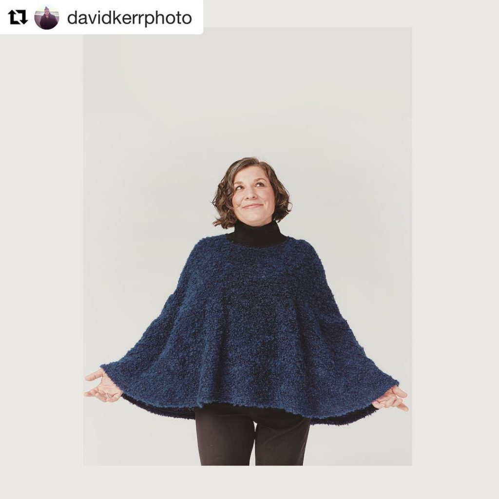 "Christa is wearing a blue cape and looking up. The image is tagged ""davidkerrphoto"""