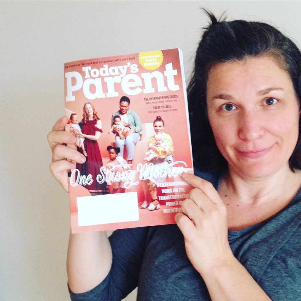 Christa is holding up a copy of Today's Parent magazine